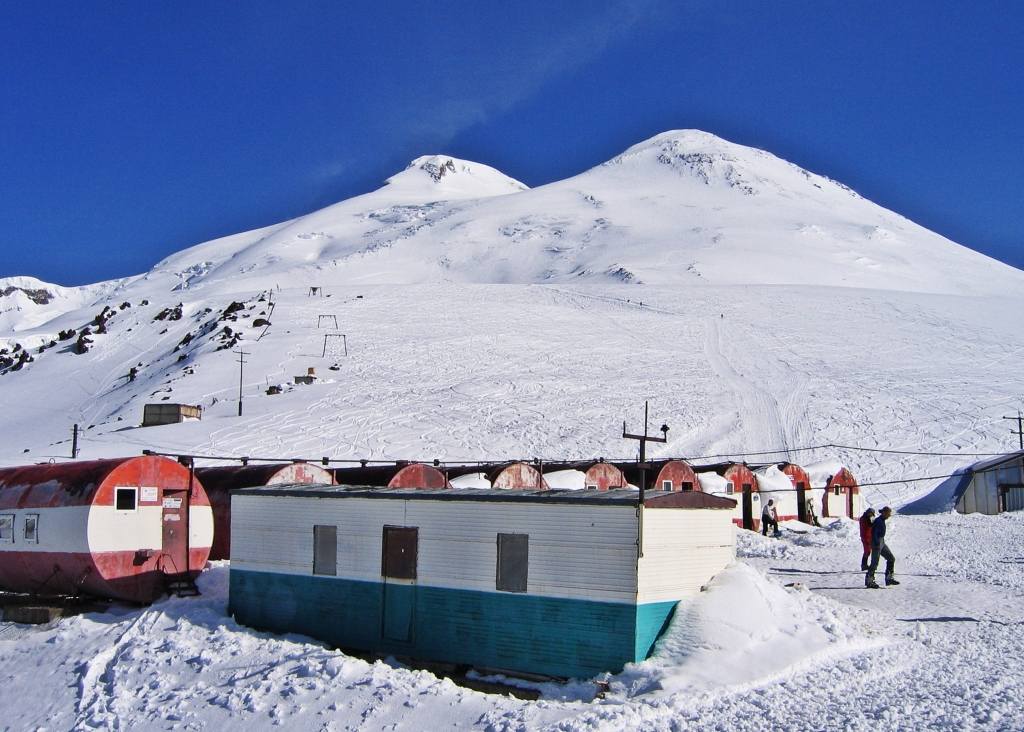 Kitchen and dining room, Barrel Huts with the twin peaks of Mount Elbrus above