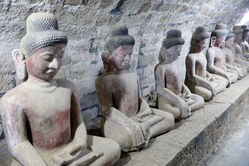 Statues in Shittaung Pagoda's outer hallway, Mrauk U