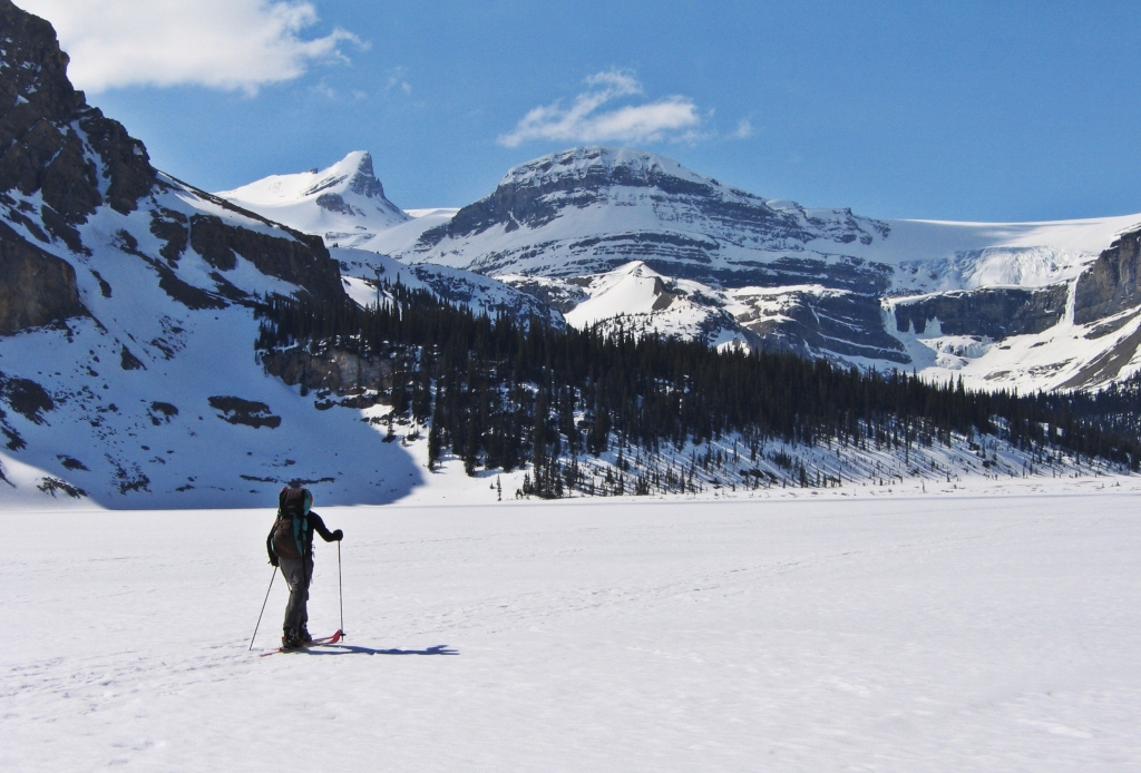 Skiing across Bow Lake with St. Nicholas above