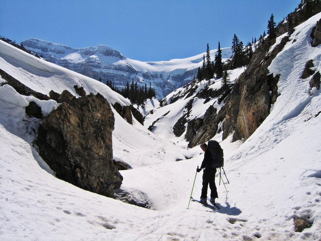 Skiing up Bow Canyon with a hanging glacier above