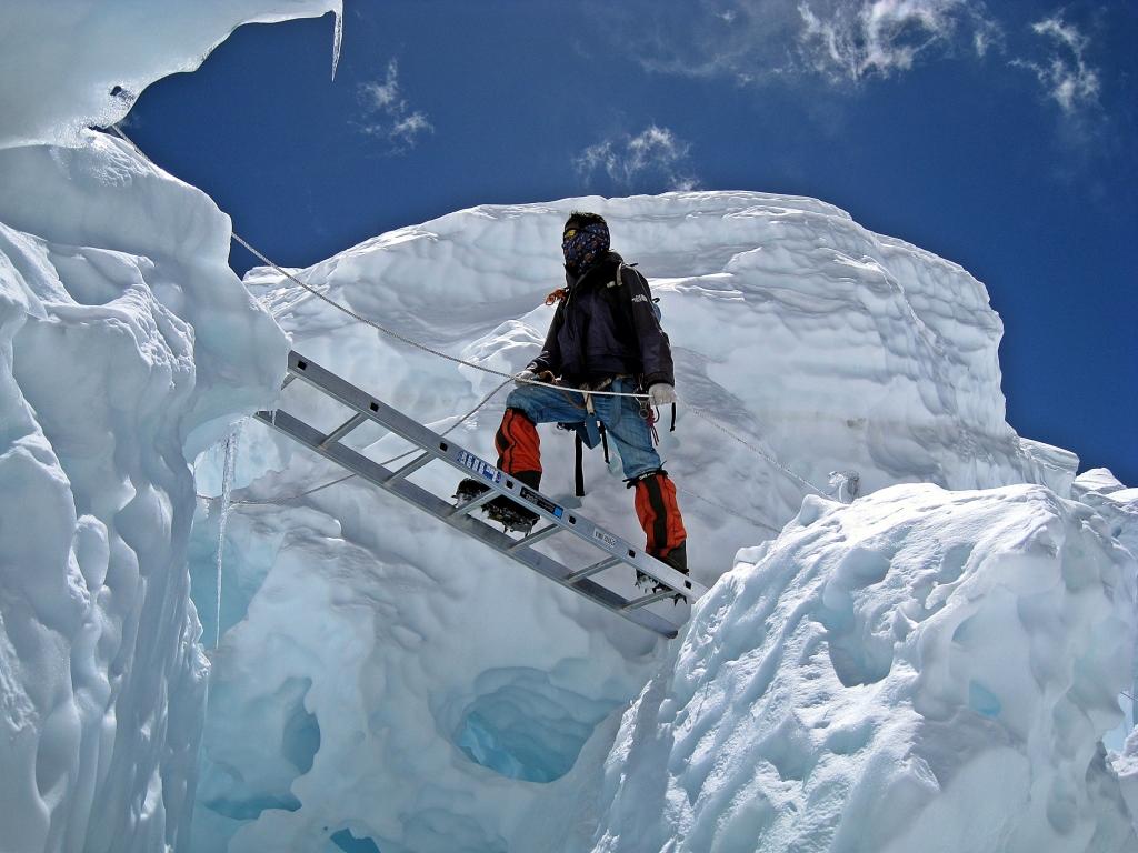 Ngima crossing a crevasse, Khumbu Icefall