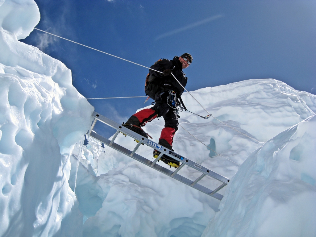 Crossing a crevasse, Khumbu Icefall