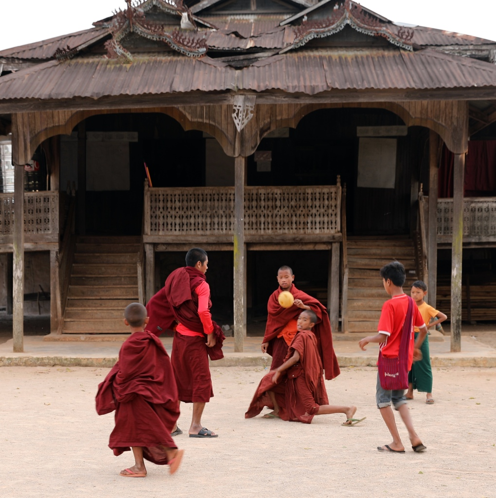 Monks playing hacky sack