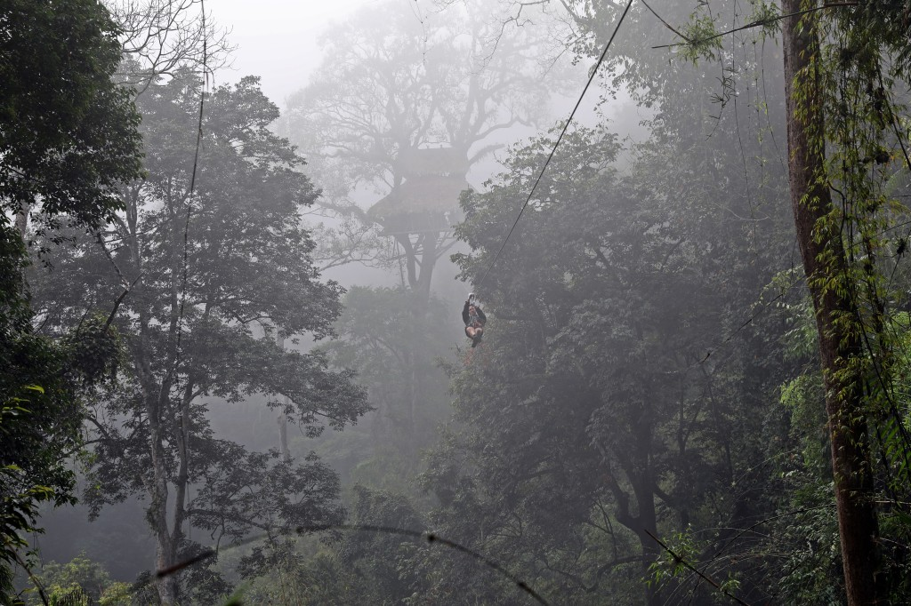 Ziplining in the morning mist, Nam Kan National Park