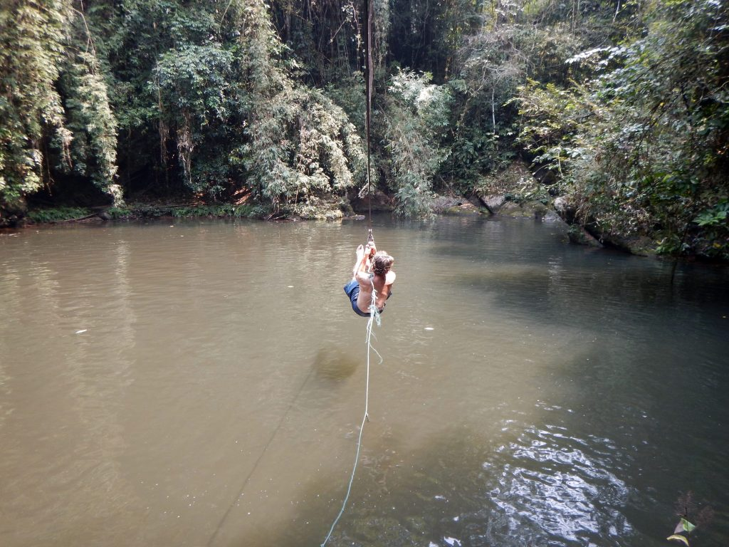 Ziplining into a pond, Nam Kan National par