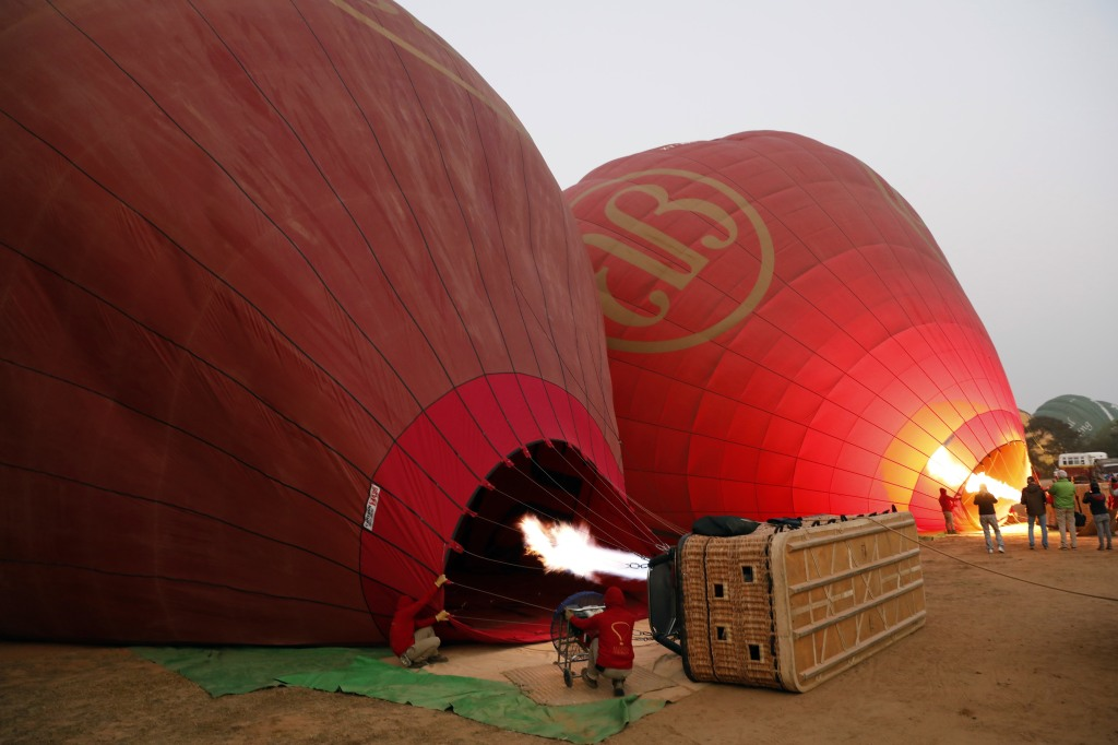 Filling up balloons with hot air, Bagan