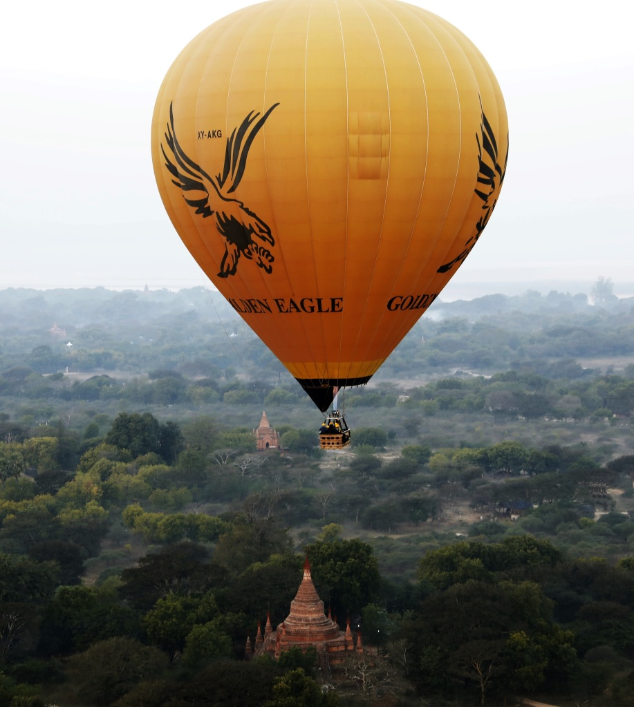 Hot air balloon over ancient temples in Bagan