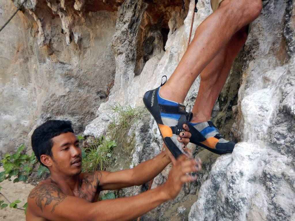 Pon cleaning Richard's climbing shoes