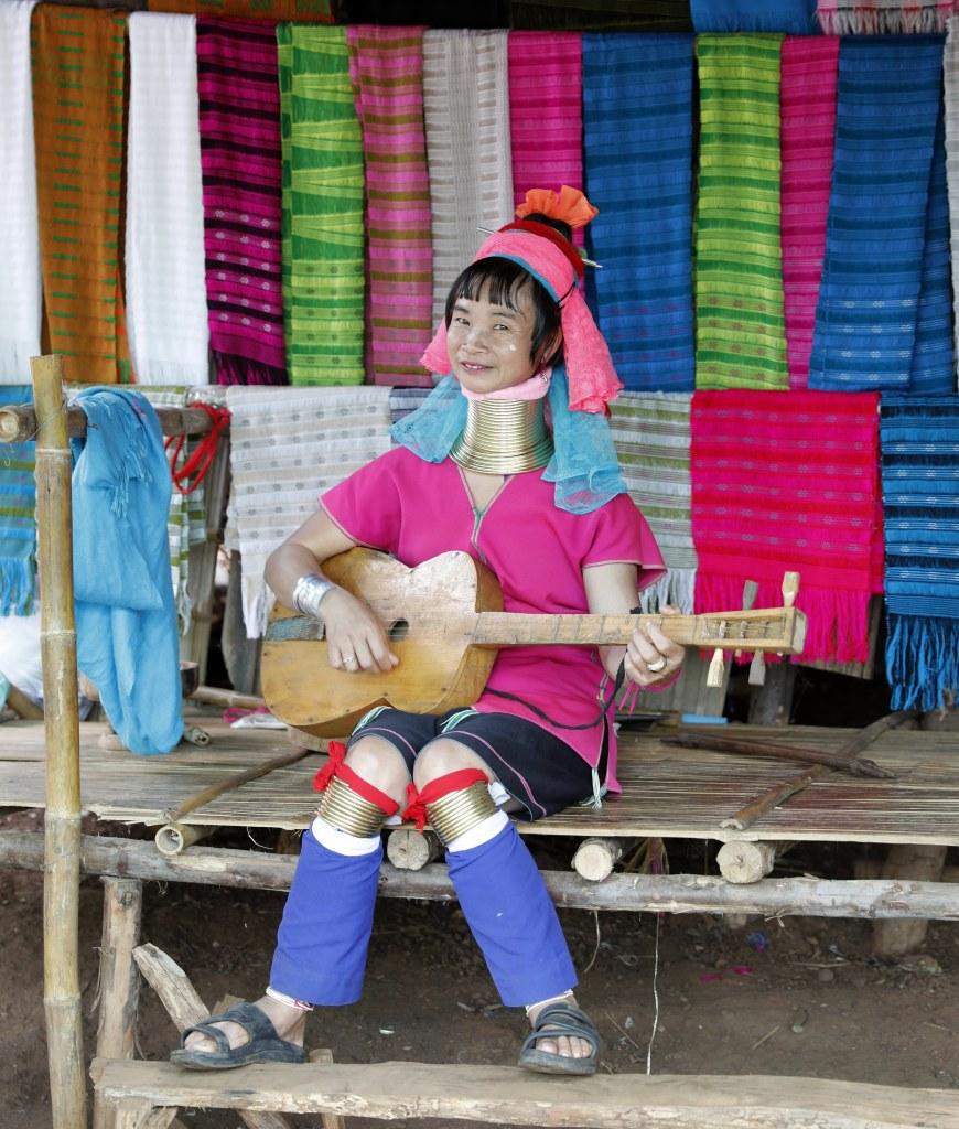 Long-Neck Karen Hilltribe Lady playing rustic guitar