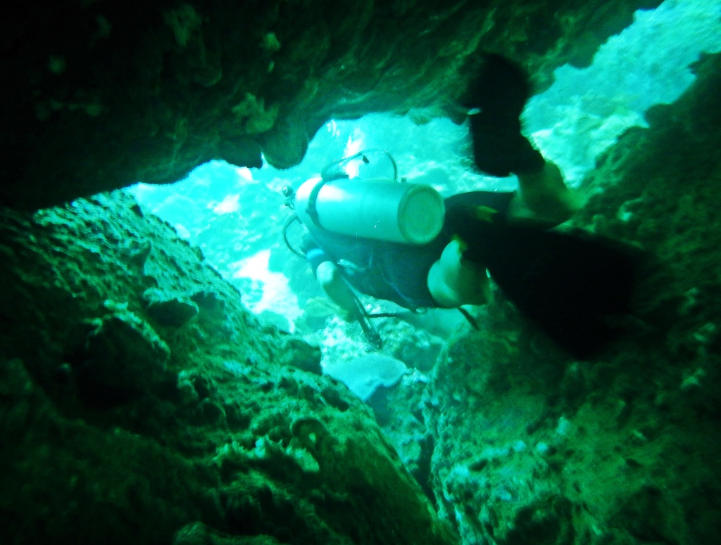 Swimming through a coral tunnel, Koh Tao
